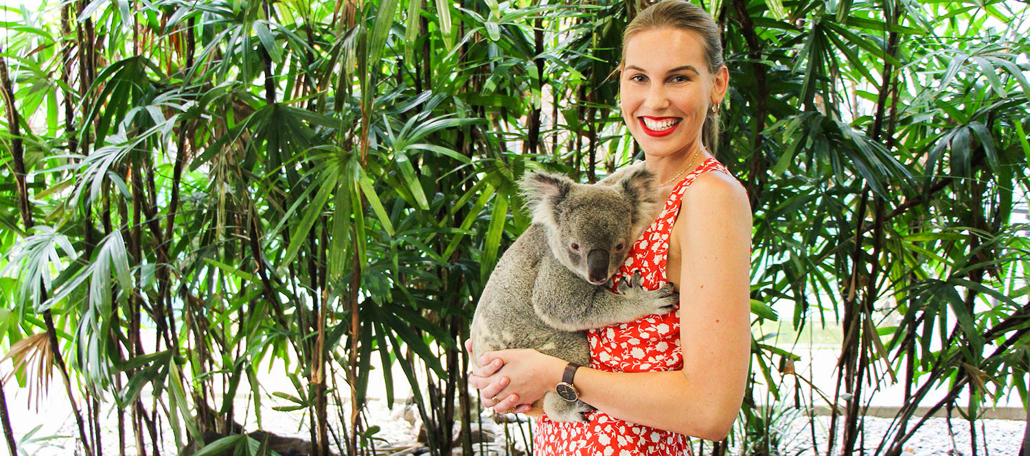 girl-holding-koala-at-wildlife-habitat-port-douglas-1